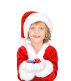 Papai Noel pequeno bonito com cartão de crédito Fotos de Stock