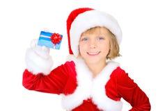 Papai Noel pequeno bonito com cartão de crédito Imagem de Stock