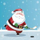 Papai Noel que joga o hóquei Fotografia de Stock Royalty Free