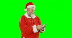 Papai Noel que usa o telefone celular filme