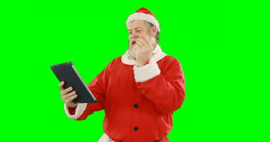 Papai Noel que usa a tabuleta digital filme