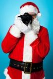 Papai Noel transforma em um pro fotógrafo Foto de Stock Royalty Free
