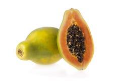 Papaia affettata isolata Fotografie Stock Libere da Diritti