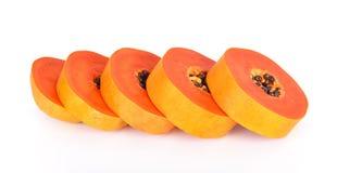 Papaia cortada em um fundo branco Imagem de Stock Royalty Free