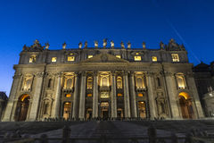 Papal basilica of Saint Peter in Vatican City, Vatican. Papal basilica of Saint Peter at night full of tourists in Vatican City, Vatican stock image