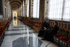Papal Basilica of Saint Peter in the Vatican Interior. VATICAN CITY, VATICAN - Nov 20, 2015: Papal Basilica of Saint Peter in the Vatican Interior. Two clerics stock photos
