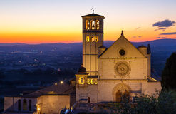 Papal Basilica of St. Francis of Assisi. The Papal Basilica of St. Francis of Assisi at sunset Assisi, Umbria, Italy stock images