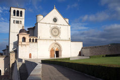 The Papal Basilica of St. Francis of Assisi. (Assisi, Umbria, Italy). The Church is on the left side of the picture Royalty Free Stock Image