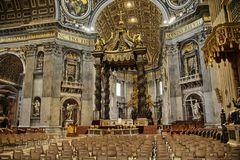 The Papal Basilica of St. Peter in the Vatican. The church is built on Vatican Hill, across the Tiber river from the historic center of Rome. The location is royalty free stock image