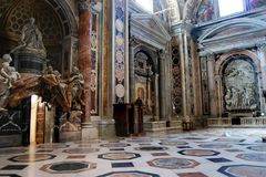 The Papal Basilica of St. Peter in the Vatican. Interior of the Papal Basilica of St. Peter in the Vatican.  The largest historical Christian church in the world Stock Photo