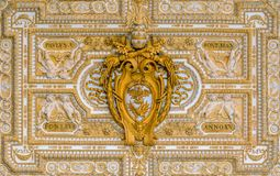 Paulus V coat of arms in the ceiling of the portico in Saint Peter Basilica in Rome, Italy. stock photo