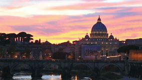 The Papal Basilica of St. Peters in Vatican, Italy. Sunset view at St. Peter Basilica in Vatican and bridge across river Tiber stock video footage