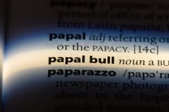 Papal bull. Word in a dictionary.  concept royalty free stock photo
