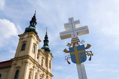 Papal coat of arms on cross, Velehrad Monastery, Czech Republic. Papal coat of arms on cross in front of the Pilgrimage Basilica of the Assumption of the Virgin stock photos