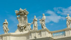 Papal crest and statues in st peter`s square vatican city. Close up of a papal crest and statues in st peter`s square vatican city royalty free stock images