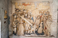 Papal Palace Avignon France. A scene of Jesus carrying the cross in bas relief inside the Papal Palace des Papes in Avignon, Provence, France stock photo