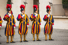 Papal Swiss Guard in uniform. VATICAN CITY, VATICAN - Nov 20, 2015: Papal Swiss Guard in uniform. Currently, the name Swiss Guard generally refers to the stock photo