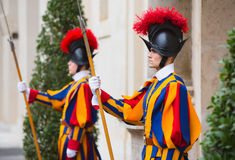 Papal Swiss Guard in uniform. VATICAN CITY, VATICAN - Nov 20, 2015: Papal Swiss Guard in uniform. Currently, the name Swiss Guard generally refers to the stock photos
