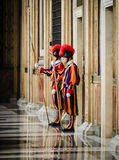 Papal Swiss Guard in uniform. VATICAN CITY, VATICAN - Nov 20, 2015: Papal Swiss Guard in uniform. Currently, the name Swiss Guard generally refers to the stock images