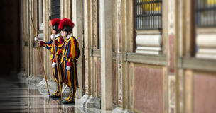 Papal Swiss Guard in uniform. VATICAN CITY, VATICAN - Nov 20, 2015: Papal Swiss Guard in uniform. Currently, the name Swiss Guard generally refers to the stock photography
