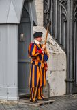 Papal Swiss Guard in uniform. Vatican - Oct 14, 2018. Papal Swiss Guard in uniform at Saint Peter Square. Swiss soldiers are a symbol of attraction in Vatican royalty free stock photography