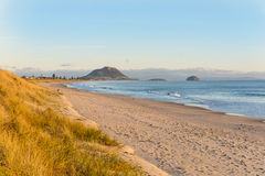 Papamoa at sunrise looking along beach Royalty Free Stock Images