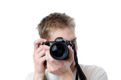 Paparazz. Takes a picture directly at you, isolated on white background Stock Image