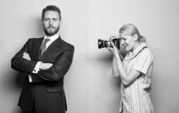 Paparazzi concept. Handsome businessman posing camera. Nice shot. Fame and success. Photographer taking photo successful stock photography