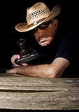 Paparazzi with cowboy hat Stock Photo