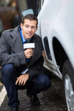 Paparazzi hiding behind car Royalty Free Stock Images