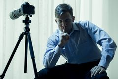 Paparazzi at home. Male paparazzi with video camera at home Stock Photography