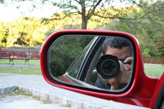 Paparazzi Man. In Car royalty free stock photography