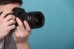 Paparazzi man taking picture with photo camera Stock Image