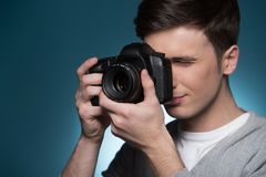 Paparazzi man taking picture with photo camera. Royalty Free Stock Images
