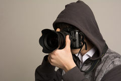 Paparazzi man taking picture with photo  DSLR digital camera.  Royalty Free Stock Images