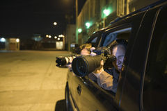 Paparazzi Photographer In Car Royalty Free Stock Image