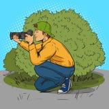 Paparazzi photographer pop art style vector. Illustration. Comic book style imitation Stock Images