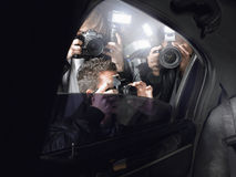 Paparazzi Shooting Through Car Window Royalty Free Stock Image