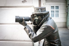 Paparazzi Statue. Bronze statue of a paparazzi taking pictures in Bratislava royalty free stock photos