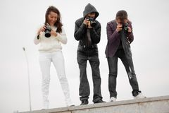 Paparazzi taking capture. People photographers stock photography