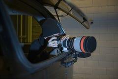 Paparazzifotograaf In Car Royalty-vrije Stock Fotografie