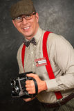 Paparazzifotograf med tappningkameran Arkivfoton