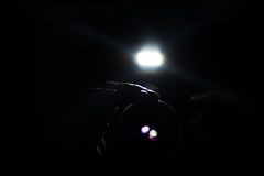 Paparazzo hidden in the dark. With a digital camera royalty free stock images