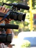 Paparrazi Cameras. Video cameras from a paparrazi crew Stock Photos