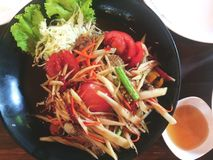 Papaya salad. Papay salad is a meal cooked by papaya, chopped or grated and sliced into strips come in a mortar into the mainstream. Along with other raw Royalty Free Stock Photography