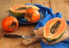 Papaya και persimmon στοκ εικόνα με δικαίωμα ελεύθερης χρήσης