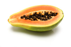 Papaya. Half a papaya fruit isolated on white studio background Royalty Free Stock Images