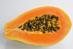 Papaya. A papaya cut in half with the seeds in the centre Royalty Free Stock Image