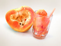 Papaya. Half & Sliced Papaya in Juice Glass royalty free stock photography