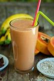 Papaya and banana smoothie with oats Stock Photos